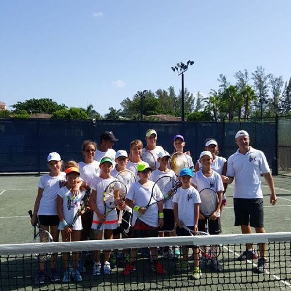 Tennis School group picture with coach