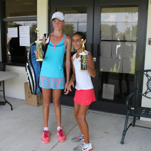 Tennis School players with trophy