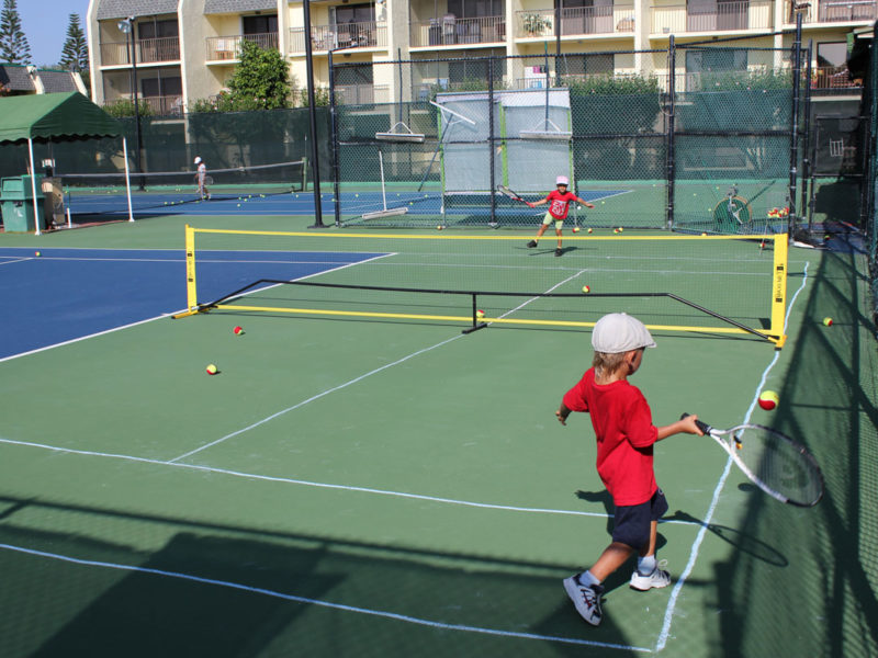 Tennis Training kids playing with each other