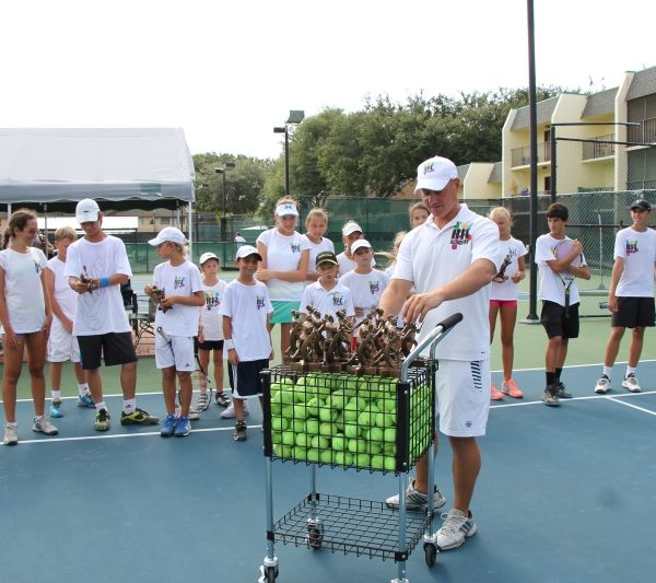 Tennis Training players with coach