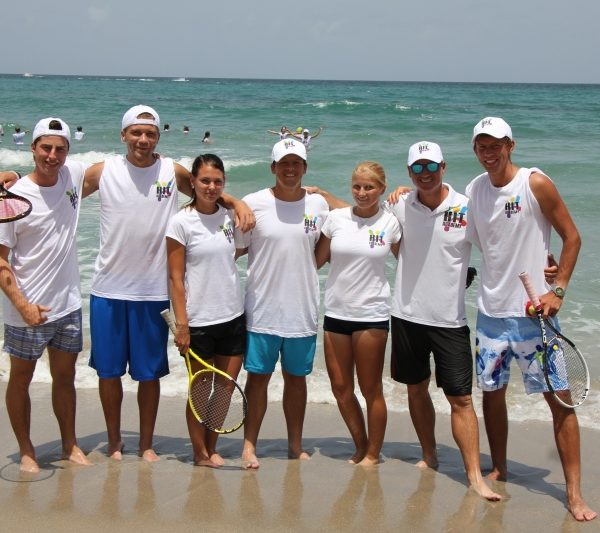 Tennis Tution players on beach